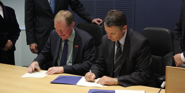 Housing Minister Nick Smith and Tauranga Mayor Stuart Crosby sign the housing accord tonight.