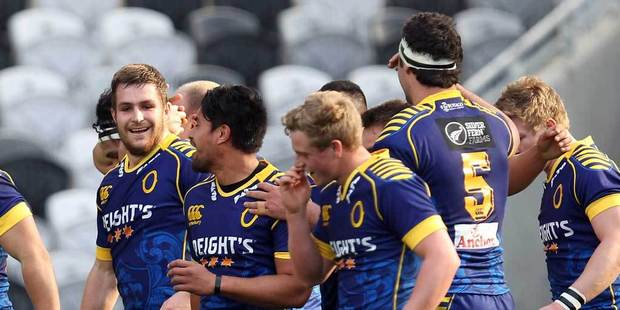 The Otago team celebrate the try of Fa'asiu Fuatai during the round one ITM Cup match between Otago and North Harbour at Forsyth Barr Stadium. Photo / Getty Images.
