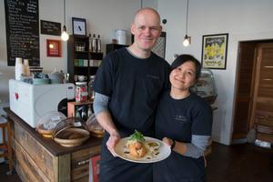Matthias and Pui Kraemer from Kramer Cafe with the German pork sausage dish. Photo / Peter Meecham.