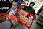 Cambridge Heights Foodmarket owner Balkar Singh pictured with his 3-year-old son Mehtaab. Photo / John Borren