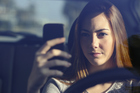 A survey has found that one in four young people in Europe have taken a selfie while driving. Photo / Getty Images