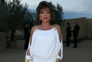 Joan Collins poses during the Leonardo Dicaprio Foundation Inaugurational Gala at Domaine Bertaud Belieu on July 23, 2014 in Saint-Tropez, France. Photo / Getty Images.
