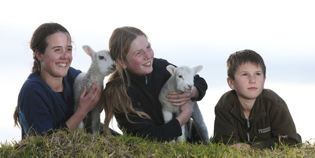 Jessica, Abby and Morgan Lusby who have adopted the two lambs after they were rejected by their mothers.