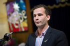 David Seymour, Act Party candidate for Epsom, addresses the floor at the public debate. Photo / Chris Loufte