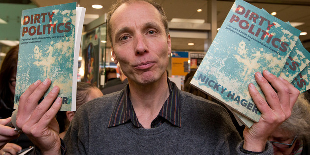 Author Nicky Hager with copies of his book, Dirty Politics. Photo / Mark Mitchell