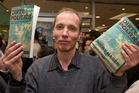 Author Nicky Hager with copies of his book, Dirty Politics, at the launch in Wellington. Photo / Mark Mitchell