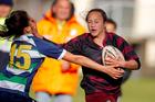 Aryahn Clarke of Te Puke (right) tries to fend off Tia Kenesa of Opotiki. Photo / George Novak