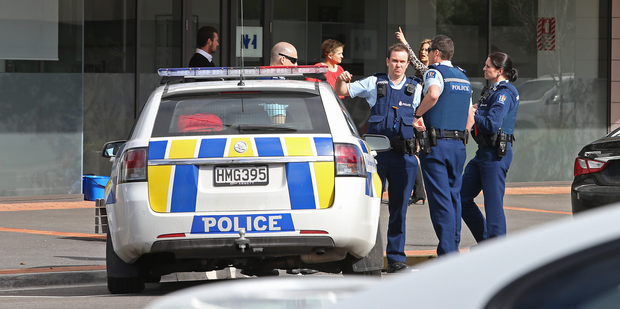 A 52-year-old woman was taken to hospital with life-threatening injuries after falling from a four-storey complex. She later died. Photo / John Borren