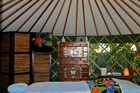 Inside the accommodation yurt at Nikau Sanctuary in Raglan. Photo / Robbyn Storey
