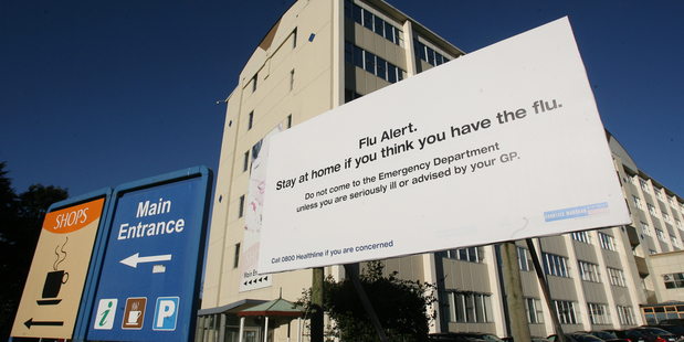 Signs like this one went up at Middlemore Hospital in Auckland when swine flu was in full force. Photo / File