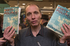 Author Nicky Hager surrounded by media at the launch of his latest book, Dirty Politics, in Wellington. 13 August 2014. New Zealand Herald Photograph by Mark Mitchell WGP 15Aug14 - RED RIBBON DAY