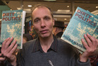 Author Nicky Hager surrounded by media at the launch of his book, Dirty Politics. Photo / Stuart Munro