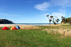 Purakaunui Bay in the Catlins is well worth enduring the winding gravel road down to the campsite for. Photo / Supplied