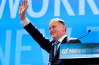 Prime Minister John Key waves to supporters. Photo / Mark Mitchell