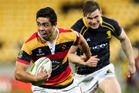 Anton Lienert-Brown of Waikato breaks away from Jason Woodward of Wellington during the round one ITM Cup match between Wellington and Waikato at Westpac Stadium in Wellington. Photo / Getty Images