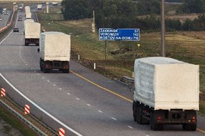 A convoy of white trucks leaves Russia bound for Ukraine. Photo / AP