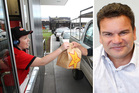 A company which helped set up a string of Carl's Jr fast food stores in New Zealand has taken a franchisee part-owned by former All Black Michael Jones to the High Court. Photos / File