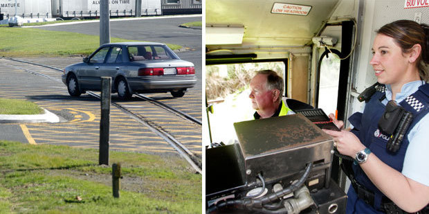 Policewoman Jemara Mackie rode the train from Wanganui East to Castlecliff with locomotive engineer John Rumbal to look out for risky drivers. Photo / Bevan Conley