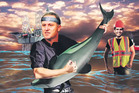 In the video, John Key plays on a Maui's dolphin while an oil rig explodes in the background.