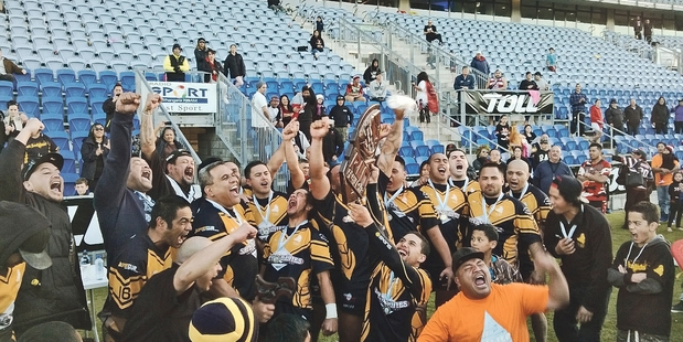 The victorious Otangarei Knights celebrate with the RLN trophy.
