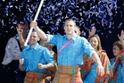 Flag-bearer Euan Burton leads the Scottish team at the Glasgow Commonwealth Games opening ceremony. Photo / AP