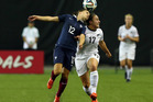 Jasmine Pereira of New Zealand and Aurelie Gagnet of France battle for the ball. Photo /Getty Images