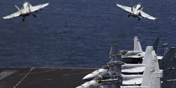 Fighter jets leave a US aircraft carrier in the Persian Gulf for a mission in Iraq. Photo / AP