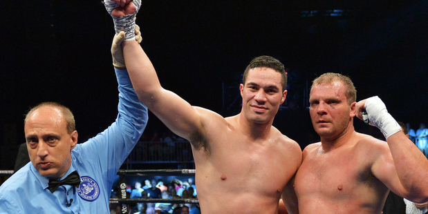 Joseph Parker of New Zealand celebrates his third round win over Keith Thompson. Photo / Getty Images