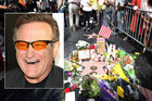 Fans leave tributes for Robin Williams beside his star on the Hollywood Walk of Fame. Photo / AP