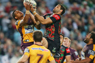 Greg Inglis of the Rabbitohs beats Ben Barba of the Broncos for a high ball before setting up the try to Luke Keary. Photo / Getty Images
