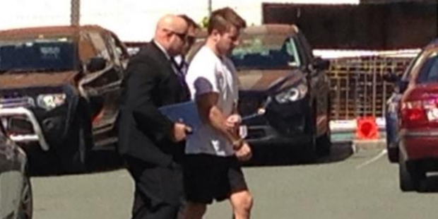 Gable Tostee being taken into custody. Photo / Carrie Greenbank / Channel 9 / Twitter