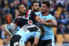 Feleti Mateo of the Warriors looks to offload in the tackle. Photo / Getty Images