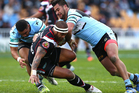 Manu Vatuvei is brought down in a tackle against the Sharks. Photo / Getty Images