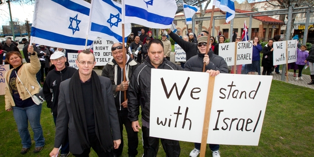 Pastor Nigel Woodley from the Flaxmere Christian Fellowship with Tony McCaw and Riki Kupa during the Standing for Israel rally at Hastings Town Clock on Saturday. Photo / Glenn Taylor