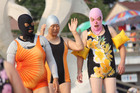Women wearing the face-kini enjoy themselves at a beach in Qingdao, China. Photo / Getty Images