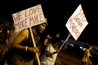 Protesters  in Ferguson  carry signs for Michael Brown, one calling for the removal of the prosecutor, Robert McCulloch, from the case. Photo / AP
