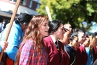 Protesters came from as far away as Auckland to support Monet-Mei Clarke (front). Photo / Michael Cunningham