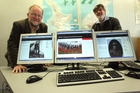 ONLINE: Archivists Gareth Winter (left) and Neil Frances with images on the new W100 website. PHOTO/LYNDA FERINGA