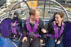 A video still-shot (above) shows the moment Katrina Genefaas proposed to boyfriend Mark Trenberth on the reverse bungy in Auckland.