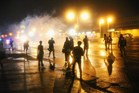 Police fire tear gas at demonstrators protesting the shooting of Michael Brown after they refused to honor the midnight curfew in Ferguson, Missouri. Photo / AFP