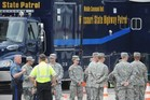 Personnel from the Missouri National Guard arrive at the Missouri Highway Patrol command center in Ferguson, Missouri. Photo / AFP
