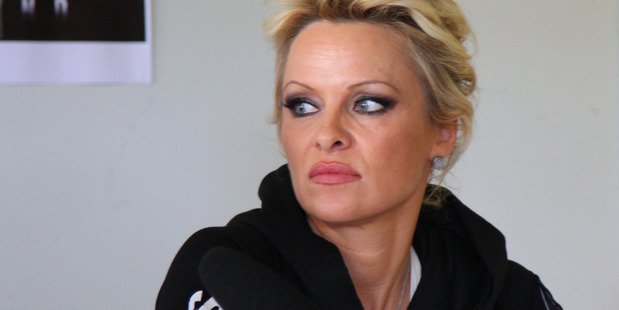 Pamela Anderson is refusing to do the ice bucket challenge over ethical claims. Photo/AP