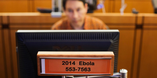 A sign designates a workstation dedicated to Ebola in the Emergency Operations Center at the US Center for Disease Control and Prevention. Photo / AP