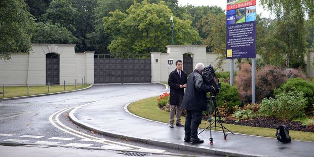 Members of the media report from outside the Charters Estate, in Berkshire, England, where British singer Cliff Richard has an apartment. Photo / AP