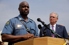 Captain Ron Johnson of the Missouri Highway Patrol, left, and Missouri Govenor Jay Nixon take part in a news conference. Photo / AP