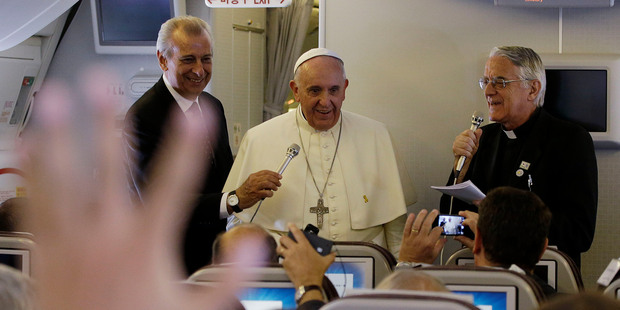 Pope Francis meets the media during an airborne press conference on his journey back to Rome from Seoul. Photo / AP