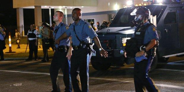 Captain Ron Johnson, center, pulls his men back during protests in Ferguson. Photo / AP
