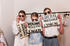 Models backstage at Karen Walker's show, carrying her statement slogan clutches. Picture / Olivia Hemus