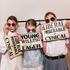 Models backstage at Karen Walker's show, carrying her statement slogan clutches. Picture / Olivia Hemus