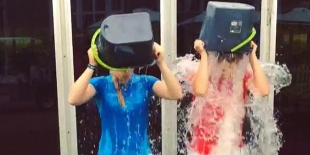 British golfer Charley Hull (left) and American golfer Camilla Lennarth take the Ice Bucket Challenge.